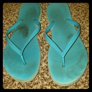 Blue well worn flipflops
